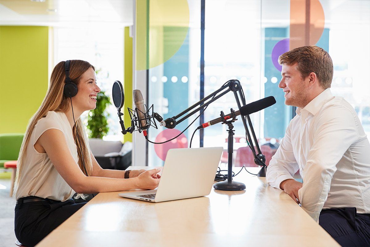 young woman interviewing a guest in a studio