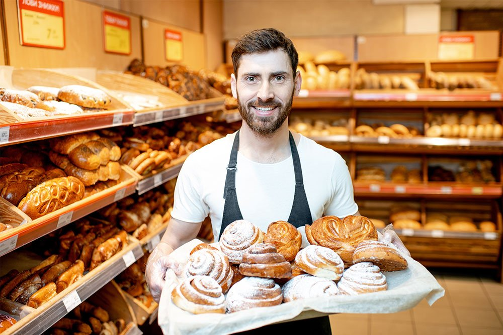 baker with fresh pastries