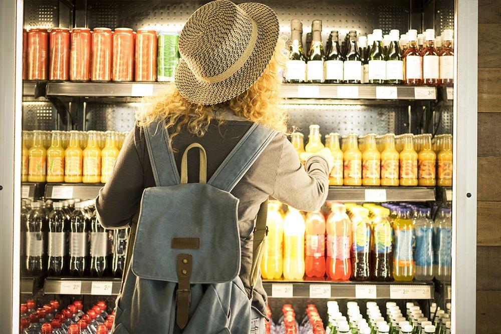travel woman viewed from back choosing beverage