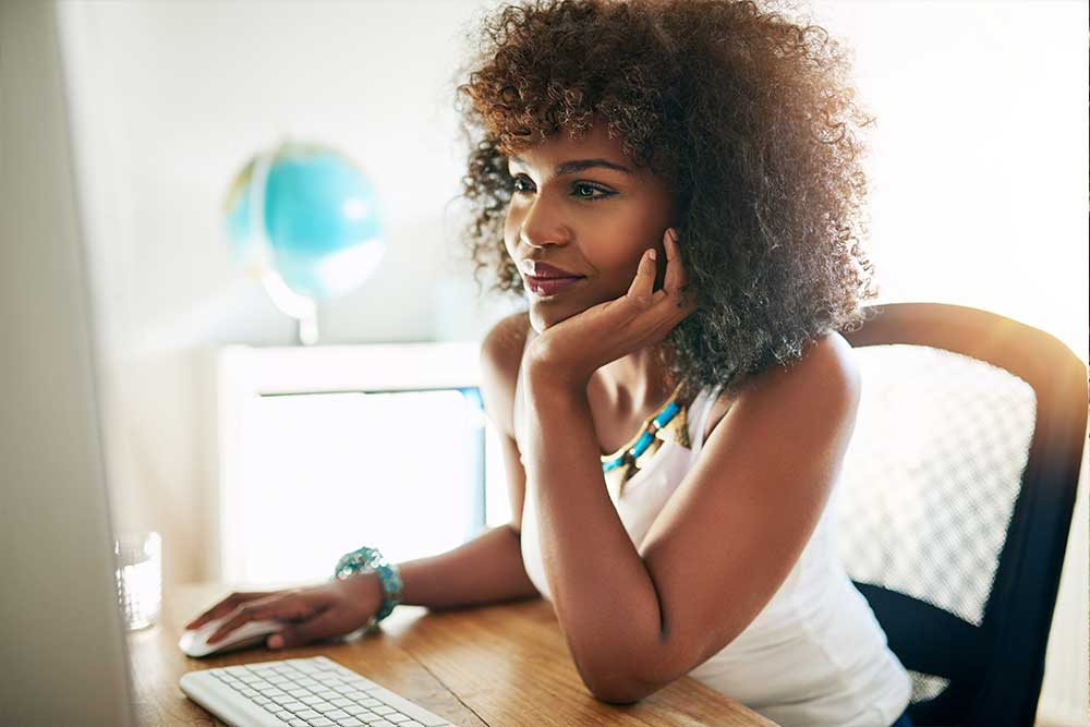 young-black-girl-working-on-computer