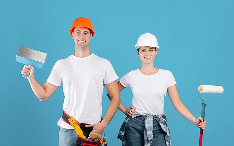 renovation-time-positive-workers couple posing wit