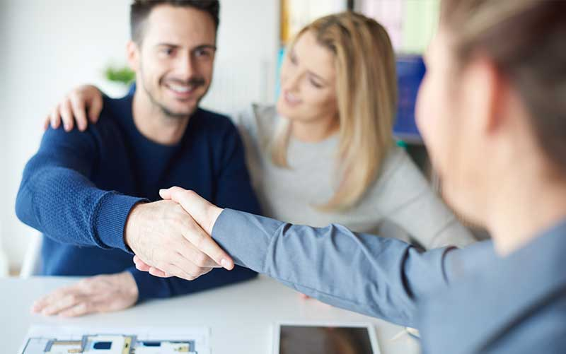 man-shaking-hands-with-real-estate-agent
